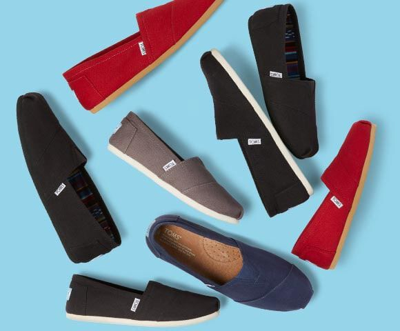 A collection of TOMS classic alpargatas in black, red, grey and navy.