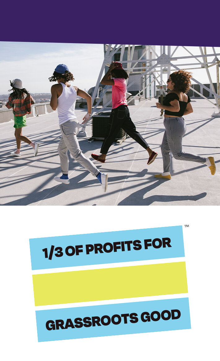 Side profile of a group of people wearing TOMS Alpargatas. TOMS Impact mark in blue and yellow. Text: ⅓ of profits for grassroots good. Trademark symbol.